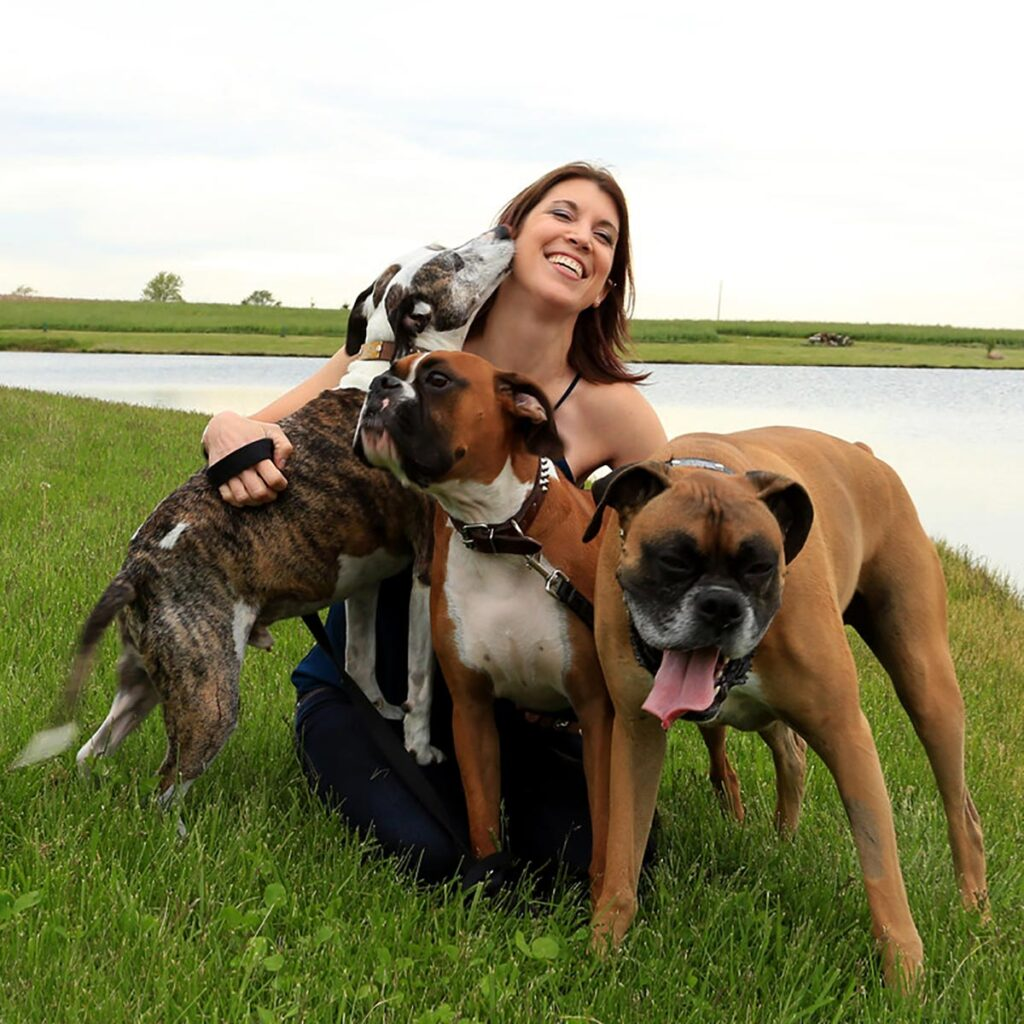 Brownsburg Animal Clinic owner Timea H. Brady, DVM, and her dogs