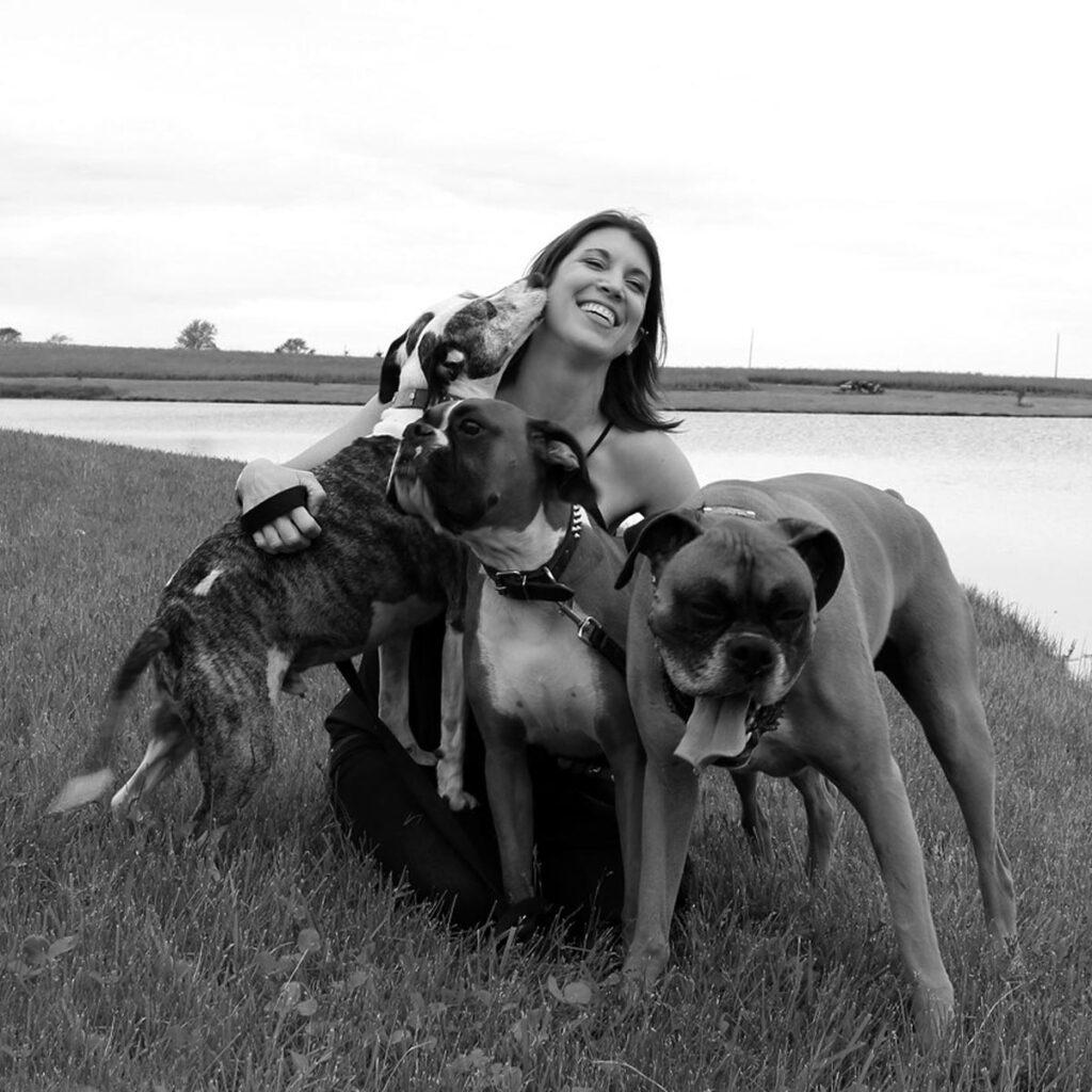 Timea H. Brady, DVM, and her dogs